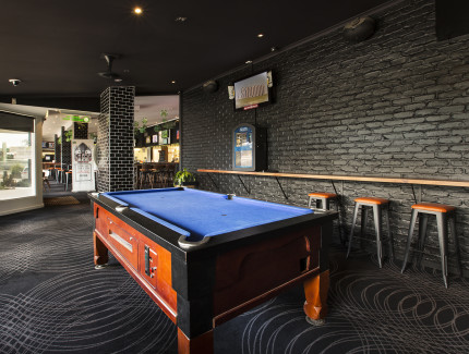 Enjoy a game of pool with friends when visiting the Lawnton Tavern