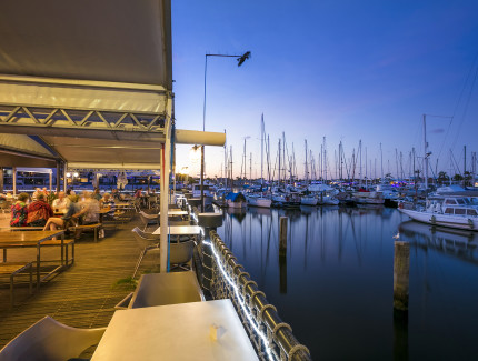 Enjoy the harbour views while dining at the Kawana Waters Hotel