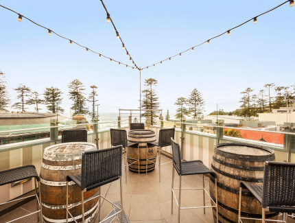 Take in the views of Manly Beach at the Rooftop Garden Bar