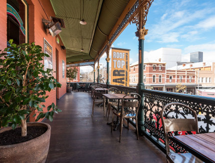 Relax with friends on the balcony at the Brass Monkey